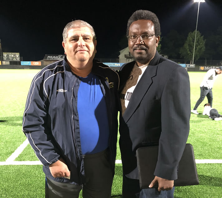 Mo Sheta (left), posing with Mid-Atlantic Conference Commissioner Andy Salandy (right).